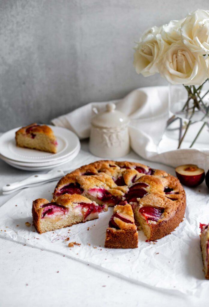 Plum Coffee Cake made with fresh sliced plums ready to serve   katiebirdbakes.com