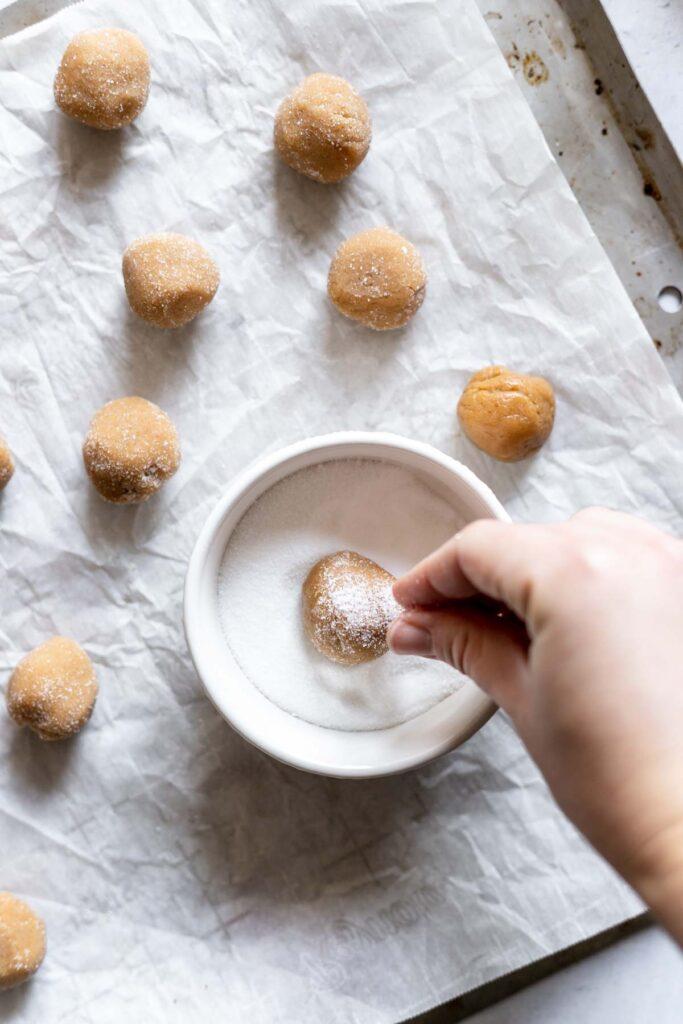 Rolling cookies in sugar
