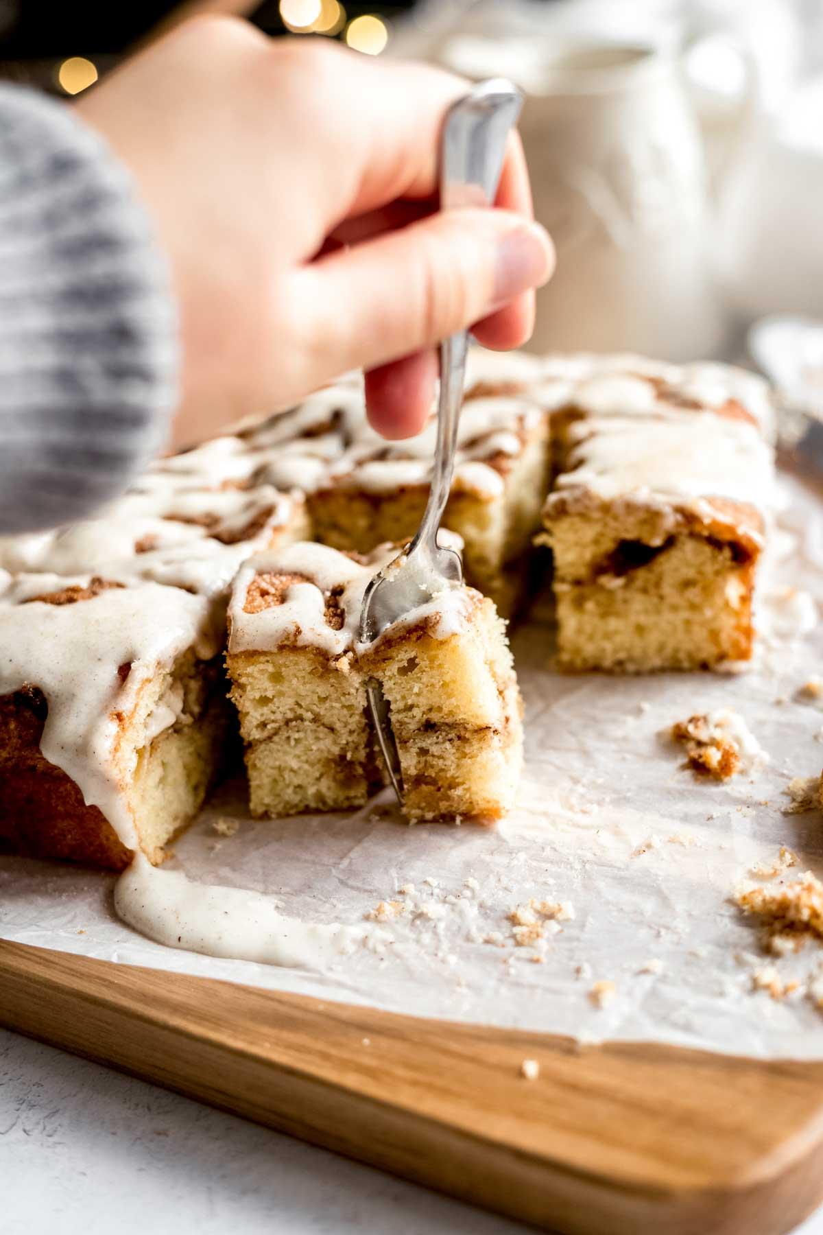 Biting into the cake - cream cheese glaze