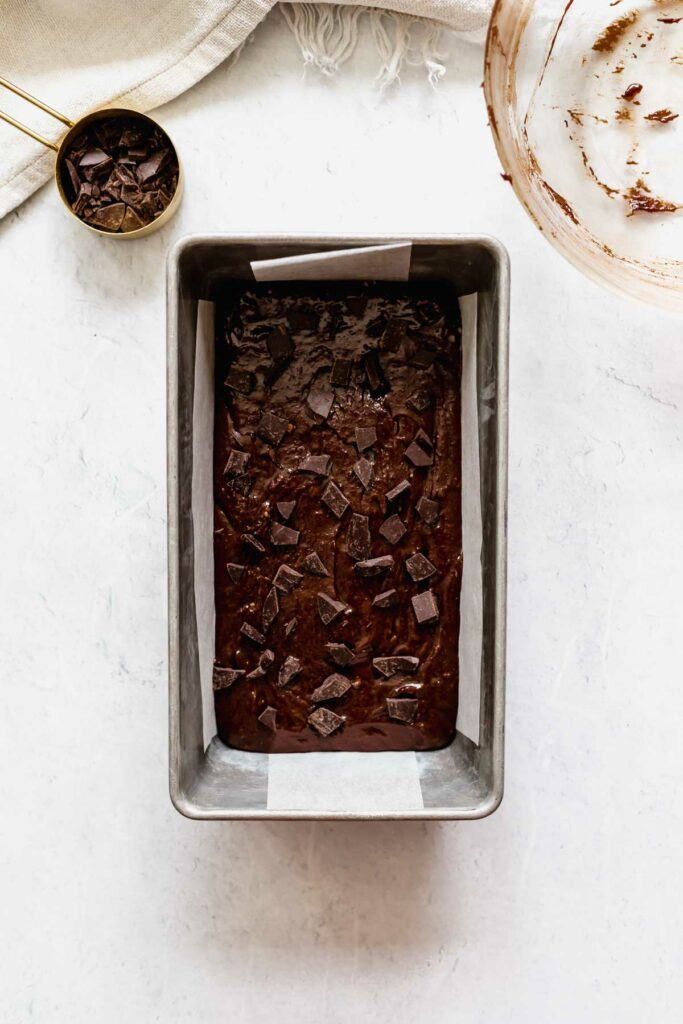 Brownie batter ready for baking in a loaf pan | katiebirdbakes